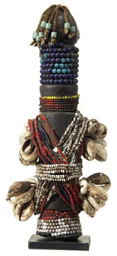 This Fali rituall doll (ham pilu) has been vetted as being authentic.  In addition to a rich display of beads, this doll is adorned with cowrie shells. Photographs © Tim Hamill