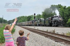 A new generation of fans waves to an old favorite as she passes by on her way to Atlanta. The Southern #630 led the way for train #955 on May 31st.