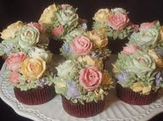 Almost too beautiful to eat cupcakes with roses and flowers icing; perfect for vintage wedding reception decor cake or bridal shower;