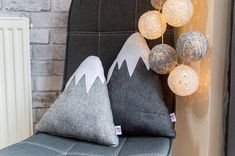 Check out this item in my Etsy shop https://www.etsy.com/listing/607508321/kids-felt-mountain-cushions-two-throw