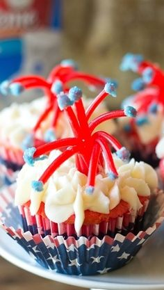 twizzler firecracker cupcakes. I'll put sparkly or gold glitter at the ends instead like how fireworks do after they pop.