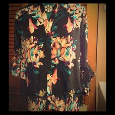 """Beautiful flower print button down blouse! Pretty floral print blouse. Button down, collared, long sleeved blouse in 100% polyester. Bust- 22"""", length is 26"""". Dana Buchman Tops Button Down Shirts"""