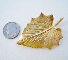 Vintage 60s Woodland Traditional Goldtone Gold Tone Autumn Fall Leaf Brooch Pin. $5.00, via Etsy.