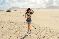 Feeling extra cool in the Corralejo desert wearing ripped shorts, Guns'n'Roses t-shirt and platform sneakers with finshnet stockings today on my blog: http://larisacostea.com/2017/02/dunas-de-corralejo/