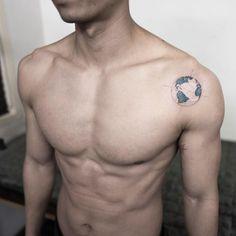 Micro globe tattoo by Hongam