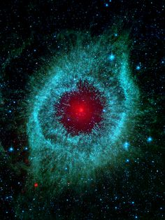 ~~Dust and the Helix Nebula ~ Dust makes this cosmic eye look red. Spitzer Space Telescope image.