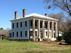 An old Greek revival plantation house outside of Greensboro, Alabama.  The brick columns and chimneys were clearly built by skilled craftsmen.