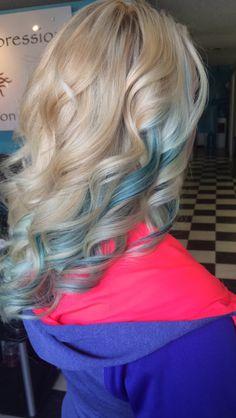 Blonde hair with peekaboos of peacock green
