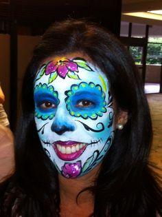 Marcela Bustamante of Blazin Brush painted on herself at FABAIC 2013, Sugar Skull face paint