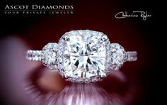 Catherine Ryder engagement ring, cushion cut center with diamond frame (halo) and round side stones, designed for Ascot Diamonds.