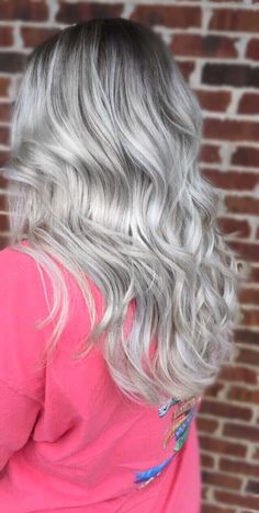 Beautiful balayage. Silver blonde with a smudged root.
