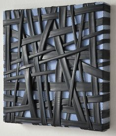 """""""Utilizing bicycle inner tubes, my abstractions create both a literal and visual tension as I vary the depth and width, direction and line through the constant pull of the material. Sculptural, yet constrained to singular planes, my works are alternative drawings retaining the aesthetic of former purpose."""" -- J.C. Smith"""
