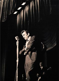Johnny Cash  Marshall Grant on stage in the mid 60s.