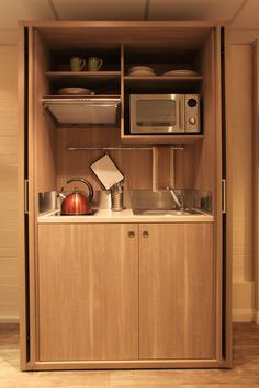 mini kitchen units shelves oven plates cups fan stove faucet sink modern style room of Several Cute Mini Kitchen Units You Definitely Have to Check Out