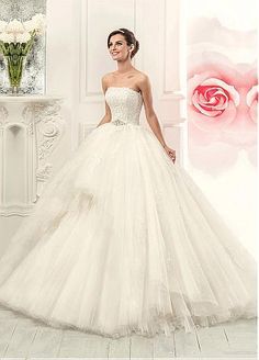 This gorgeous ballgown can be converted to a shorter dress, so you can still dip your toes in the water.  Glamorous Tulle Strapless Neckline 2 In 1 Wedding Dress With Lace Appliques