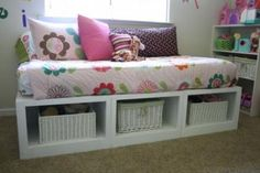 Can you build a box? What about three boxes? Then put some trim on the outside edges? Yes? Then you can build a storage bed like this one. The Storage Daybed is actually made up of three benches, very different benches than the Queen-Sized. These benches are much more simple. Thank you readers for the photos! Special thanks to Kara for sharing her amazing bed.