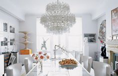 Not a huge fan of all wine glass chandeliers - but as an actual rack for practical use (if that's what this really is) - this is a beautiful statement piece for the kitchen. Chic and Shimmering Chandeliers
