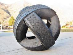 Picture of tire ball.  This is a giant ball made from three intersecting semi truck tires. A cool sculpture or fun for tykes to climb on.