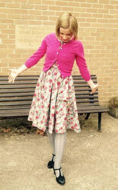 Pretty Person in a Pink Cardigan..... Must be Lucy Worsley!