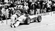 Parnelli Jones lost his brakes. His pit crew tries to stop his car during the 1962 Indy 500.