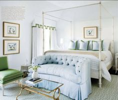 pale blue and kelly green, rug, loveseat at end of bed, table, green chair