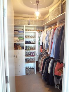 Rods on long wall, open shelves and drawers on the back wall. Use our big baskets up top for storage.