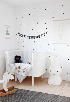 Cute black and white baby nursery, dots on the wall, bunny lamp.