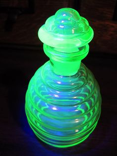 Stunning blacklight picture of a Depression era Uranium glass perfume bottle. $50 @Amy Lyons S on Etsy.