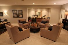 Basement layout pic #3 with wet bar, would add a small bar with seats.  Love the 4 chairs with ottoman table