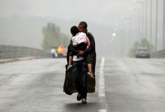 The Pulitzer Prize for breaking news photography has been jointly won by Reuters and The New York Times for images of the refugee crisis in Europe and the Middle East. New York Times, Muammar Gaddafi, World Press Photo, Fotografia Macro, Refugee Crisis, Syrian Refugees, Kissing Him, Persecution, Photos Of The Week