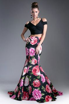 Two Piece Set Long Prom Dress has Open Midriff, Solid Color Cropped Top with Deep V Neck, Cutout Shoulders and Zipper Back Closure, This Dress also features Trumpet Shape, Floral Print Embellished Skirt with Train Detail.