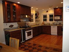 trying to see examples of wood floors with stained cabinets.  I like the medium floors with med-dark cabinets!