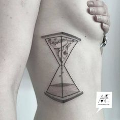 Gorgeous hourglass tattoo on ribcage by Axel Ejsmont