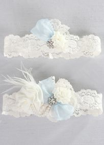 "Add something blue to your day with this vintage inspired lace garter set. Adorned with crystals pearl beads, chiffon flowers feathers, and a blue bow this delicate garter set will be something to cherish for years to come.  Features and Facts:   15"" around unstretched 1.25"" W.  Each garter set includes a keepsake garter and a toss garter."