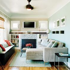Small Living Room Interior Design With Soft Blue Wall Scheme And Grey Sofa  Sets