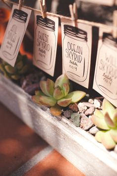 mason jar images used to write in seating assignments  Photography By / floatawaystudios.com