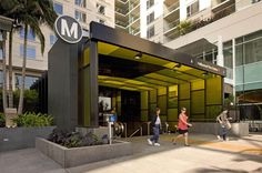 "Rios Clementi Hale Studios was commissioned to create a covered entryway for an existing Metro subway stop, and an engaging plaza surrounding it. Bordered on three sides by a multi-use project, the entry canopy and adjacent common areas artfully merge into the ground plane of Hollywood Boulevard, serving as a pedestrian threshold and grand ""front"