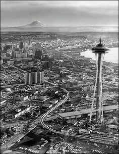 Old Seattle,,,*Looks like this shows building the Seattle Center for the 1962 World's Fair, with the Space Needle and monorail tracks already in place.