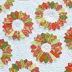 12 New Ideas for Dresden Quilt Patterns | FaveQuilts.com-12 New Ideas for Dresden Quilt Patterns is a collection of our favorite quilt block designs, home decor projects, quilted sofa throws, and baby blankets that all showcase darling Dresden plate patterns. Regardless if you are a beginner or advanced quilter, you are sure to find a free Dresden plate pattern to enjoy piecing or appliqueing together.