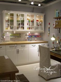 like the cabinet idea with the glass fronts for my room.  And love the rolls for wrapping paper!