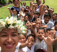 Nan of Pacific Resort Rarotonga leading the Avarua Primary School kids