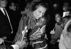 Israeli Prime Minister Golda Meir receives a warm hug from a pupil during a visit to Fourth Street Elementary School in Milwaukee on Oct. 3, 1969