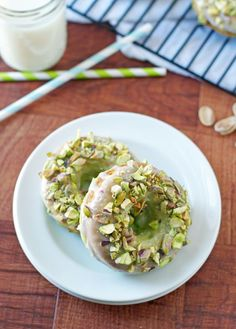 Baked Pistachio Pudding Donuts - Perfect for St. Patrick's Day! Pudding mix makes these amazingly soft and fluffy.