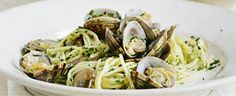 Vongole or clams make a classic Italian supper tossed with linguine and herbs. The clams are cooked in dry white wine, which combined with the natural clam juice make a lovely rich sauce for the pasta. Serve as a smart main for 2 or a starter for 4.