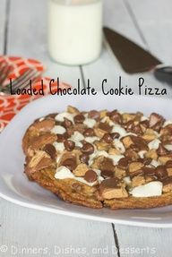 Loaded Chocolate Cookie Pizza ngredients  Chocolate Chip Cookie Dough (store bought, or recipe here)  Marshmallows  Reeses Peanut Butter Cups, chopped  Chocolate Chips  Hot Fudge