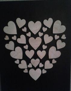 canvas doek zwart spuiten, de hartjes in de vorm van een groot hart met een lijmpistool er opplakken en voila !  ( alles verkrijgbaar bij de Action)