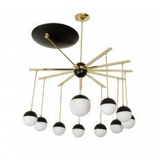 Eleven arm brass and black enamel chandelier featuring opaque white glass shades and saucer shaped reflector. Origin: Italy Circa: 1960