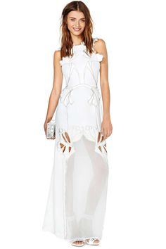 Amazing white maxi dress featuring embroidered gray detailing and architectural cutouts. Fitted w...