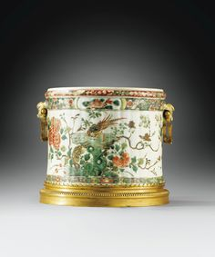 A GILT-BRONZE MOUNTED CHINESE FAMILLE VERTE PORCELAIN POT HOLDER, THE PORCELAIN QING DYNASTY, KANGXI PERIOD (1662-1722), THE MOUNTS LOUIS XIV