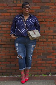 I love the dots, navy/red combo. The jeans make her look approachable and sexy instead of dressy.